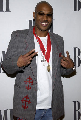 FILE – In this May 17, 2005, file photo, Mario Winans, of Fort Lee, N.J., arrives at the BMI Pop Music Awards in Beverly Hills, Calif. Federal prosecutors in New Jersey say Winans pleaded guilty Thursday, Sept. 29, 2016, to willfully failing to file tax returns from 2008 to 2012, and faces two years in prison and a $200,000 fine. (AP Photo/Matt Sayles, File)