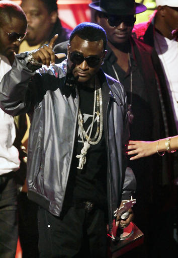 In this Oct. 18, 2008 file photo, Shawty Lo accepts the Rookie of the Year award during the BET Hip Hop Awards in Atlanta. Authorities say rapper Shawty Lo, whose real name is Carlos Walker, has been killed in a fiery car crash before dawn Wednesday, Sept. 21, 2016 on a freeway near southwest Atlanta. (AP Photo/John Amis, File)