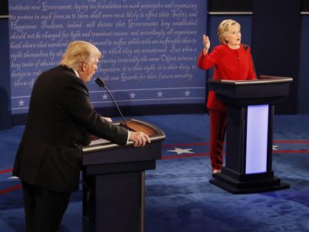 Republican presidential nominee Donald Trump and Democratic presidential nominee Hillary Clinton speak at the same time during the presidential debate at Hofstra University in Hempstead, N.Y., Monday, Sept. 26, 2016. (Rick T. Wilking/Pool via AP)