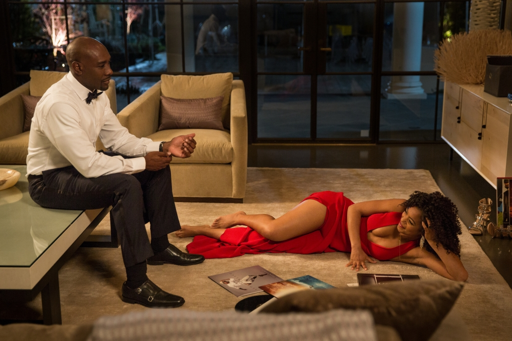 John Taylor (MORRIS CHESTNUT) and Anna Walsh (JAZ SINCLAIR); 2am... John lets the last catering staff out... heads up to bed and hears music; John finds Anna playing music in the living room in Screen Gems' WHEN THE BOUGH BREAKS.