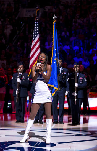 """Philadelphia 76ers' Dancer Jemila performs the national anthem prior to an NBA basketball game against the Oklahoma City Thunder, Wednesday, Oct. 26, 2016, in Philadelphia. Philadelphia 76ers national anthem singer Sevyn Streeter said she was told by the team she could not perform because of her """"We Matter"""" jersey. The Sixers had Jemila sing the anthem. (AP Photo/Chris Szagola)"""