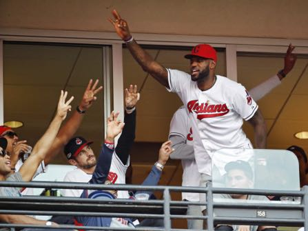FILE - In this Oct. 15, 2016, file photo, Cleveland Cavaliers' LeBron James stands during the seventh inning in Game 2 of baseball's American League Championship Series between the Cleveland Indians and the Toronto Blue Jays in Cleveland. When LeBron James and the Cavaliers, whose historic comeback in June against Golden State in the NBA Finals ended Cleveland's title drought dating to 1964, receive their championship rings and a banner is raised in Quicken Loans Arena before their season opener, the emotional ceremony will merely be the warm-up act. Next door, at Progressive Field, the Indians will host the Chicago Cubs in Game 1 of the World Series.  (AP Photo/Gene J. Puskar, File)