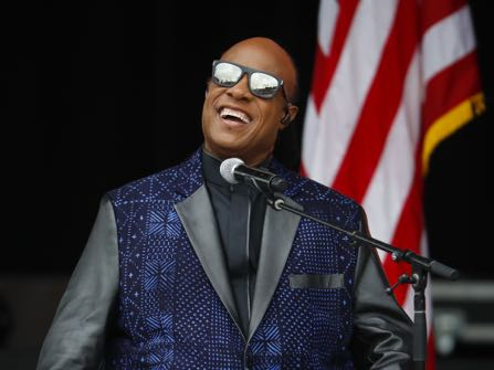 FILE - In this Sept. 24, 2016 file photo, singer Stevie Wonder performs at the dedication ceremony for the Smithsonian Museum of African American History and Culture on the National Mall in Washington. Wonder is one of the featured performers who will pay tribute to Prince at a Minnesota concert Thursday night Oct. 13, 2016. (AP Photo/Pablo Martinez Monsivais, File)