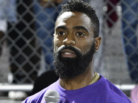 Former Olympian Tyson Gay speaks to the mourners gathered in memory of his daughter at Lafayette High School, Monday, Oct. 17, 2016, in Lexington, Ky. Trinity Gay, the 15-year old daughter of Tyson Gay was shot and killed early Sunday morning, Oct. 16, 2016, (AP Photo/Timothy D. Easley)