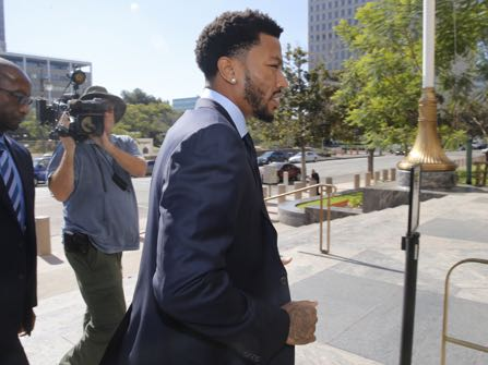 New York Knicks guard Derrick Rose, right, arrives at Los Angeles U.S. District Court downtown Los Angeles on Thursday, Oct. 6, 2016. A six-woman, two-man jury has been seated in the trial of a civil lawsuit brought against New York Knicks guard Derrick Rose by an ex-girlfriend who alleges the NBA star and two of his friends drugged and sexually assaulted her. (AP Photo/Damian Dovarganes)