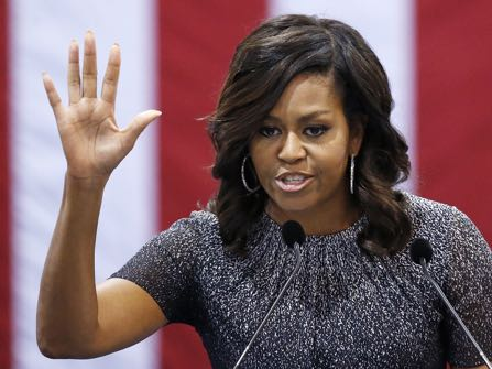 First lady Michelle Obama waves to the crowd after speaking during a campaign rally for Democratic presidential candidate Hillary Clinton Thursday, Oct. 20, 2016, in Phoenix. (AP Photo/Ross D. Franklin)