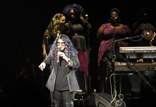 Tyka Nelson, Prince's sister, appears on stage during a tribute concert honoring the late musician at Xcel Arena, Thursday, Oct. 13, 2016, in St. Paul, Minn. Prince died in April of an accidental overdose. (AP Photo/Jim Mone)