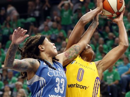 Minnesota Lynx's Seimone Augustus, left, disrupts a shot attempt by Los Angeles Sparks' Alana Beard in the first quarter during Game 5 of the WNBA basketball finals Thursday, Oct. 20, 2016, in Minneapolis. (AP Photo/Jim Mone)