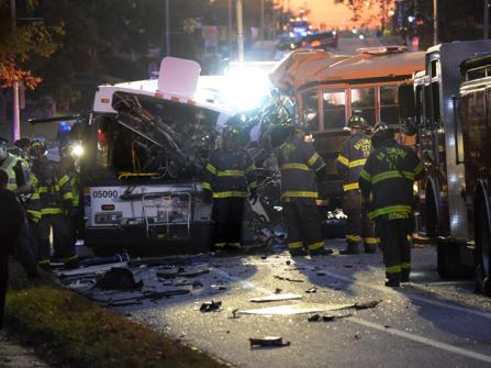 Fire department and rescue officials are at the scene of an early morning fatal collision between a school bus and a commuter bus Tuesday, Nov. 1, 2016, in Baltimore. (Jeffrey F. Bill/Baltimore Sun via AP)