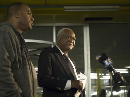Congressman Danny Davis, right, and his son, Stacey Wilson, speak during a press conference at the 5th District police department, Friday, Nov. 18, 2016, in the Englewood neighborhood. Fifteen-year-old Jovan Wilson, the grandson of Danny Davis and son of Stacey Wilson, was shot and killed while staying at his house, Friday evening. Jovan was a sophomore at Perspective high school. (Alyssa Pointer/ Chicago Tribune)