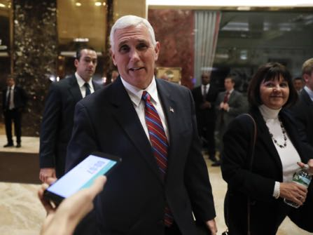 Vice President-elect Mike Pence walks past media as he leaves Trump Tower with his wife Karen, Tuesday, Nov. 15, 2016, in New York. (AP Photo/Carolyn Kaster)