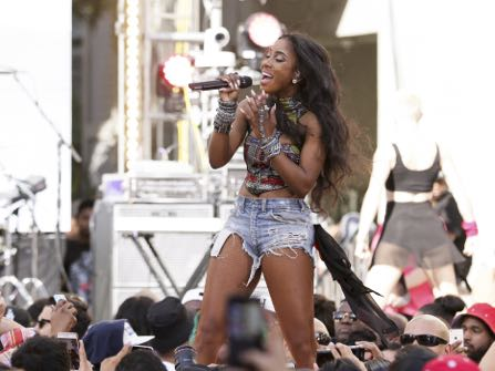 "FILE - This April 1, 2015 photo, Sevyn Streeter performs on stage at the ""Furious 7"" Takeover held at the Revolt Live Studios in Los Angeles. Streeter and the Philadelphia 76ers have decided on a date for the singer to come back and perform the national anthem after the team didn't allow her to sing wearing a ""We Matter"" jersey. In statements to the Associated Press on Saturday, Nov. 5, 2016, the 76ers and Streeter said she would perform wearing her ""We Matter"" jersey at the team's Dec. 16 home game against the Los Angeles Lakers.(Photo by John Salangsang/Invision/AP)"