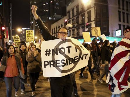 Protesters march North on State Street the day after Donald Trump was won the President Elect Wednesday, Nov. 9, 2016 in Chicago, Ill. (Armando L. Sanchez/Chicago Tribune)