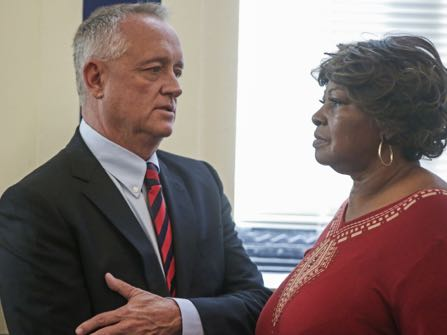 HOLD FOR TUESDAY, NOV. 22 – FILE – In this Nov. 1, 2016, file photo, Hamilton County Prosecutor Joe Deters, left, speaks with Audrey DuBose, right, the mother of Sam DuBose, in a courtroom at the Hamilton County Courthouse in Cincinnati. Hamilton County, Ohio, Prosecutor Joe Deters scheduled a Tuesday, Nov. 22, 2016, news conference to discuss the prosecution of white former University of Cincinnati police officer Ray Tensing, after a jury deadlocked and a judge declared a mistrial Nov. 12, 2016, on charges of murder and voluntary manslaughter in the fatal July 2015 shooting of black motorist Sam DuBose. (Carrie Cochran/The Cincinnati Enquirer via AP, Pool, File)