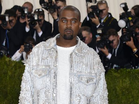 "Kanye West arrives at The Metropolitan Museum of Art Costume Institute Benefit Gala, celebrating the opening of ""Manus x Machina: Fashion in an Age of Technology"" on Monday, May 2, 2016, in New York. (Photo by Evan Agostini/Invision/AP)"