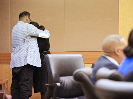 LaPrincia Brown, right, the half-sister of Bobbi Kristina Brown, is comforted by their father Bobby Brown, after taking the witness stand in a wrongful death case against Bobbi Kristina's partner, Nick Gordon, in Atlanta, Thursday, Nov. 17, 2016. Bobbi Kristina Brown was found face-down and unresponsive in a bathtub in her suburban Atlanta townhome in January 2015. (AP Photo/David Goldman, Pool)