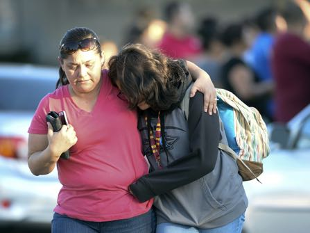 A parent picks up her daughter at Slauson Middle School that was on lochdown as Azusa police and other agencies respond to a shooting near Fourth Street and Orange Avenue in Azusa Calif. on Tuesday November 8, 2016. (Photo by Keith Durflinger/San Gabriel Valley Tribune/SCNG)