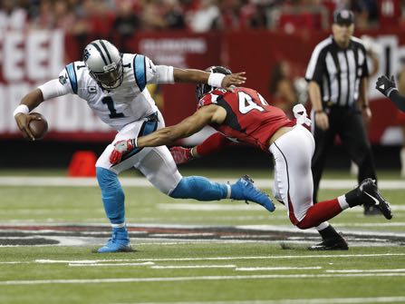 Carolina Panthers quarterback Cam Newton (1) runs out of the pocket against Atlanta Falcons outside linebacker Vic Beasley (44) during the first half of an NFL football game, Sunday, Oct. 2, 2016, in Atlanta. (AP Photo/John Bazemore)