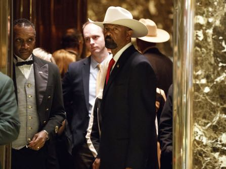 Milwaukee Sheriff David Clarke gets on an elevator after arriving at Trump Tower, Monday, Nov. 28, 2016, in New York. (AP Photo/ Evan Vucci)