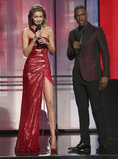 Hosts Gigi Hadid, left, and Jay Pharoah appear at the American Music Awards at the Microsoft Theater on Sunday, Nov. 20, 2016, in Los Angeles. (Photo by Matt Sayles/Invision/AP)
