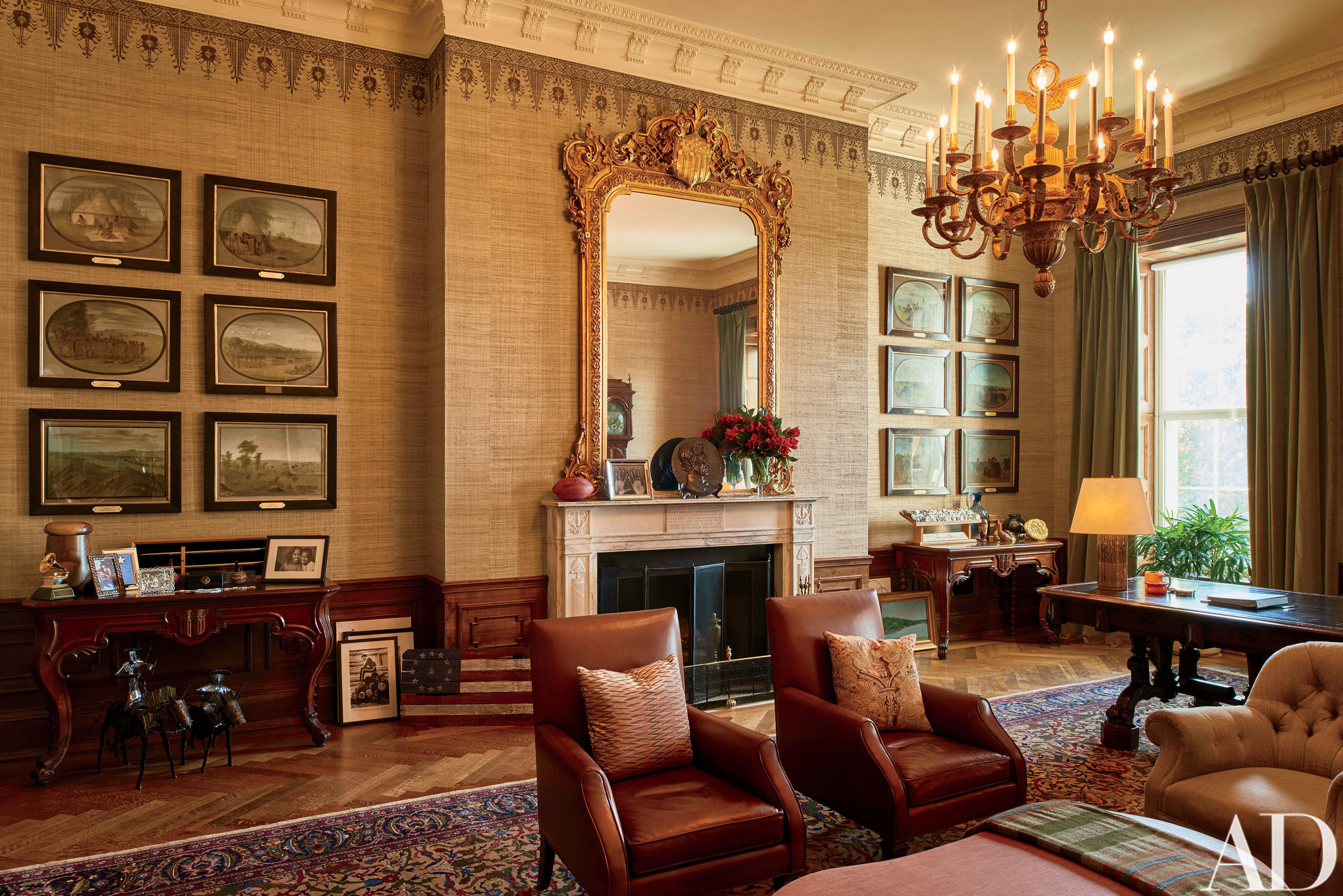 "This image provided by Architectural Digest shows The Treaty Room in the White House in Washington in August 2016. The Treaty Room is filled with memorabilia including one of President Barack Obama's two Grammy Awards, family photos, and a personalized football. It's also where Obama often retreats late at night. He uses the room's namesake table, which has been in the White House since 1869, as a desk. Obama likes to say the White House is the ""people's house."" The Architectural Digest photos are giving the public its first glimpse of private areas on the second floor of the White House that Obama, his wife, Michelle, daughters Malia and Sasha and family dogs Bo and Sunny have called home for nearly eight years.(Michael Mundy/Architectural Digest via AP)"