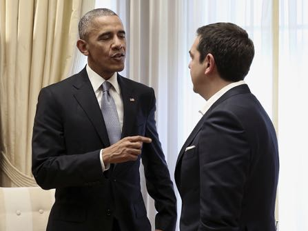 U.S. President Barack Obama, left, speaks with Greek Prime Minister Alexis Tsipras during their meeting at Maximos Mansion in Athens on Tuesday, Nov. 15, 2016. Obama is praising Greece for its financial commitment to NATO — specifically, for being one of five NATO allies that dedicated at least 2 percent of its gross domestic product to defense spending. (Simela Pantzartzi/Pool Photo via EPA)