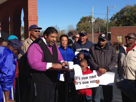 The Rev. William Barber, president of the North Carolina state NAACP, speaks during a news conference in Wilson, N.C., on Saturday, Nov. 5, 2016. Voting activists and volunteers fanned out over the presidential battleground of North Carolina on Saturday's final day of early in-person voting to urge undecideds and the otherwise uninterested to cast ballots in close races for president, U.S. Senate and governor. (AP Photo/Gary Robertson)