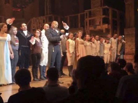 "In this image made from a video provided by Hamilton LLC, actor Brandon Victor Dixon who plays Aaron Burr, the nation's third vice president, in ""Hamilton"" speaks from the stage after the curtain call in New York, Friday, Nov. 18, 2016. Vice President-elect Mike Pence is the latest celebrity to attend the Broadway hit ""Hamilton,"" but the first to get a sharp message from a cast member from the stage. (Hamilton LLC via AP)"