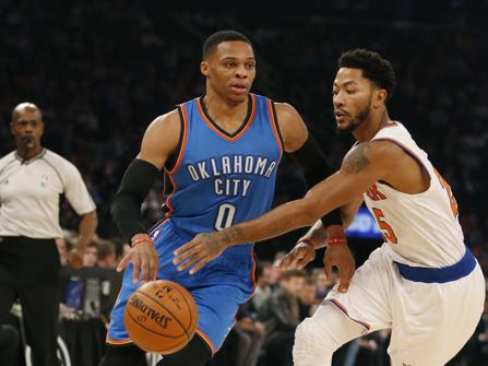 New York Knicks guard Derrick Rose (25) challenges Oklahoma City Thunder guard Russell Westbrook (0) as Westbrook drives to the basket in the first half of an NBA basketball game at Madison Square Garden in New York, Monday, Nov. 28, 2016. The Thunder defeated the Knicks 112-103. (AP Photo/Kathy Willens)