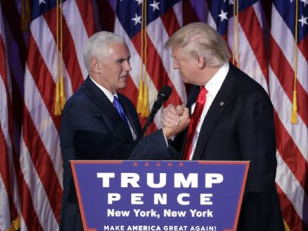 President-elect Donald Trump shakes hands with Vice-President-elect Mike Pence as he gives his acceptance speech during his election night rally, Wednesday, Nov. 9, 2016, in New York. (AP Photo/John Locher)