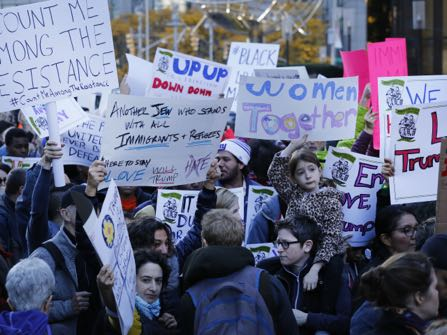 Thousands of immigrants and supporters protest anticipated immigration policies of president-elect Donald Trump during a march, Sunday, Nov. 13, 2016 in New York. (AP Photo/Mark Lennihan)