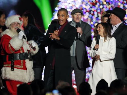 "President Barack Obama, sings ""Jingle Bells,"" with Santa Claus, James Taylor, Eva Longoria, and Garth Brooks during the lighting ceremony for the 2016 National Christmas Tree is seen before the lighting ceremony on the Ellipse near the White House, Thursday, Dec. 1, 2016 in Washington. (AP Photo/Alex Brandon)"
