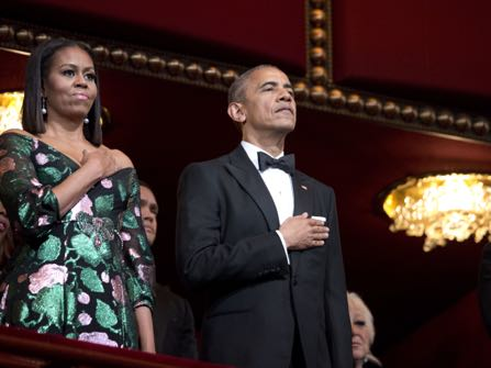 President Barack Obama And First Lady Michelle Put Their Hand Over Heart As