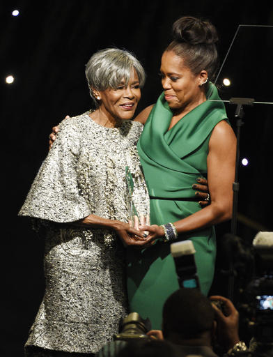 Honoree Cicely Tyson, left, accepts her award from presenter Regina King at the 2016 EBONY Power 100 Gala at the Beverly Hilton on Thursday, Dec. 1, 2016, in Beverly Hills, Calif. (Photo by Chris Pizzello/Invision/AP)