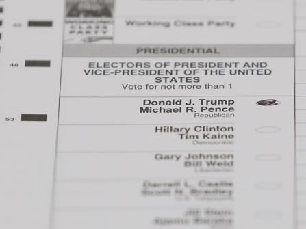 A ballot with a vote for Donald J. Trump is shown during a statewide presidential election recount in Waterford Township, Mich., Monday, Dec. 5, 2016. (AP Photo/Paul Sancya)