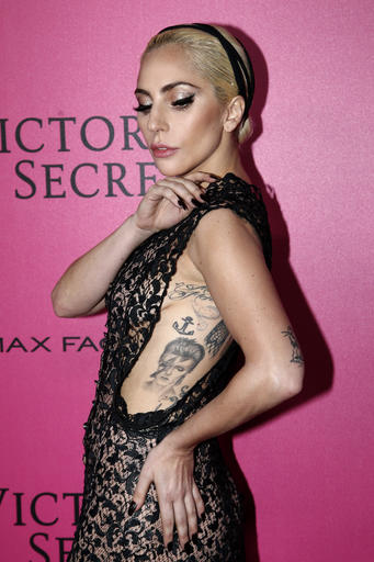 Lady Gaga poses for photographers before the Victoria's Secret fashion show Wednesday, Nov. 30, 2016 in Paris. The pulse-quickening, celebrity-filled catwalk event of the year: the Victoria's Secret fashion show takes place in Paris with performances from Lady Gaga and Bruno Mars. (AP Photo/Thibault Camus)