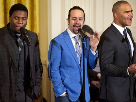 "FILE - In this March 14, 2016 file photo shows actors, from left, Okieriete Onaodowan, Lin-Manuel Miranda and Christopher Jackson perform the song ""Alexander Hamilton"" from the Broadway play ""Hamilton"" in the East Room of the White House in Washington. Miranda, who was everywhere in popular culture this year, was named The Associated Press Entertainer of the Year, voted by members of the news cooperative. (AP Photo/Jacquelyn Martin, File)"