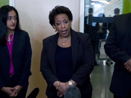 """FILE - In this May 5, 2015 file-pool photo, Attorney General Loretta Lynch, center, accompanied by Assistant Attorney General for the Civil Rights Division Vanita Gupta, speaks with reporters after a meeting with community activists at Baltimore University in Baltimore, Md. Lynch on Thursday, Dec. 15, 2016, stepped up the pressure on Baltimore officials to reach a deal with the federal government to overhaul the city's police practices, saying """"the ball is in the city's court"""" to conclude negotiations soon. (AP Photo/Jose Luis Magana, Pool, File)"""