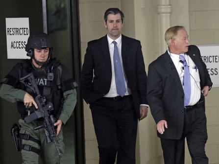 Former North Charleston police officer Michael Slager, center, is escorted from the courthouse during his murder trial at the Charleston County court in Charleston, S.C., Friday, Dec. 2, 2016. The case of a former South Carolina police officer charged with murder in the shooting death of an unarmed black motorist is now before the jury. (AP Photo/Chuck Burton)
