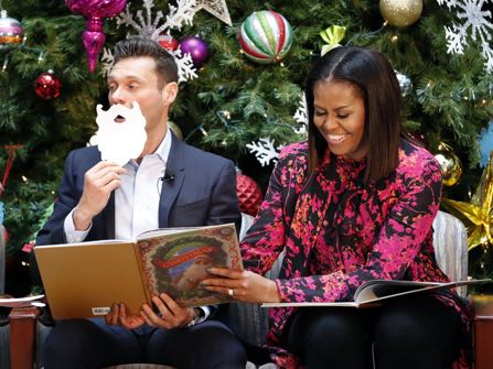 "First lady Michelle Obama, right, with television and radio host Ryan Seacrest, read ""Twas the Night Before Christmas,"" during a holiday event at Children's National Health System on Monday, Dec. 12, 2016 in Washington. Obama toured the facility, visited with patients and families, read ""Twas the Night Before Christmas"" to children and participated in a broadcast with Seacrest. (AP Photo/Alex Brandon)"