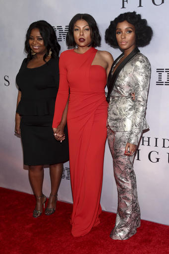 """Octavia Spencer, from left, Taraji P. Henson and Janelle Monae attend the special screening of """"Hidden Figures"""" at the SVA Theatre on Saturday, Dec. 10, 2016, in New York. (Photo by Andy Kropa/Invision/AP)"""