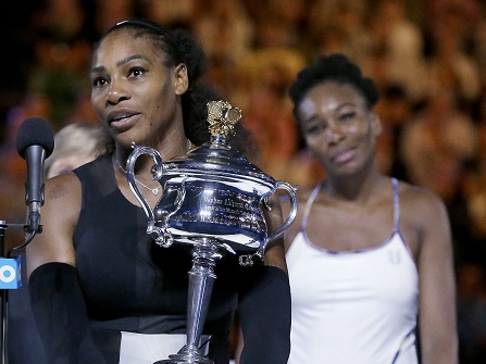 United States' Serena Williams, left, holds her trophy after defeating her sister, Venus, right, in the women's singles final at the Australian Open tennis championships in Melbourne, Australia, Saturday, Jan. 28, 2017. (AP Photo/Aaron Favila)
