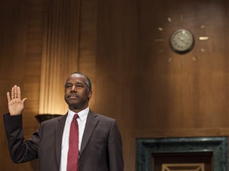 Secretary of Housing and Urban Development-designate Ben Carson is sworn in at the start of a Senate Banking, Housing, and Urban Affairs Committee hearing to confirm his nomination on Capitol Hill in Washington, Thursday, Jan. 12, 2017. (AP Photo/Zach Gibson)
