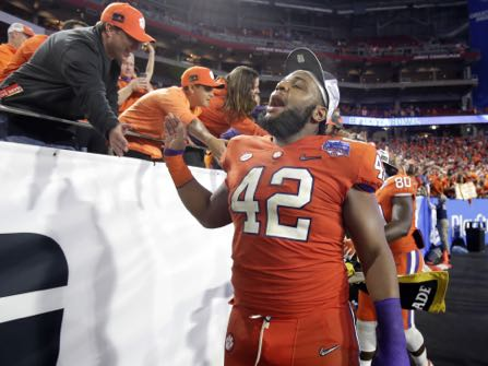 Clemson defensive lineman Christian Wilkins (42) greets fans after the Fiesta Bowl NCAA college football game against Ohio State, Saturday, Dec. 31, 2016, in Glendale, Ariz. Clemson won 31-0 to advance to the BCS championship game on Jan. 9th against Alabama. (AP Photo/Rick Scuteri)