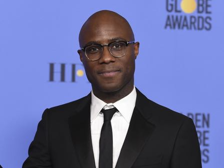 """Barry Jenkins poses in press room with the award for best motion picture - drama for """"Moonlight"""" at the 74th annual Golden Globe Awards at the Beverly Hilton Hotel on Sunday, Jan. 8, 2017, in Beverly Hills, Calif. (Photo by Jordan Strauss/Invision/AP)"""