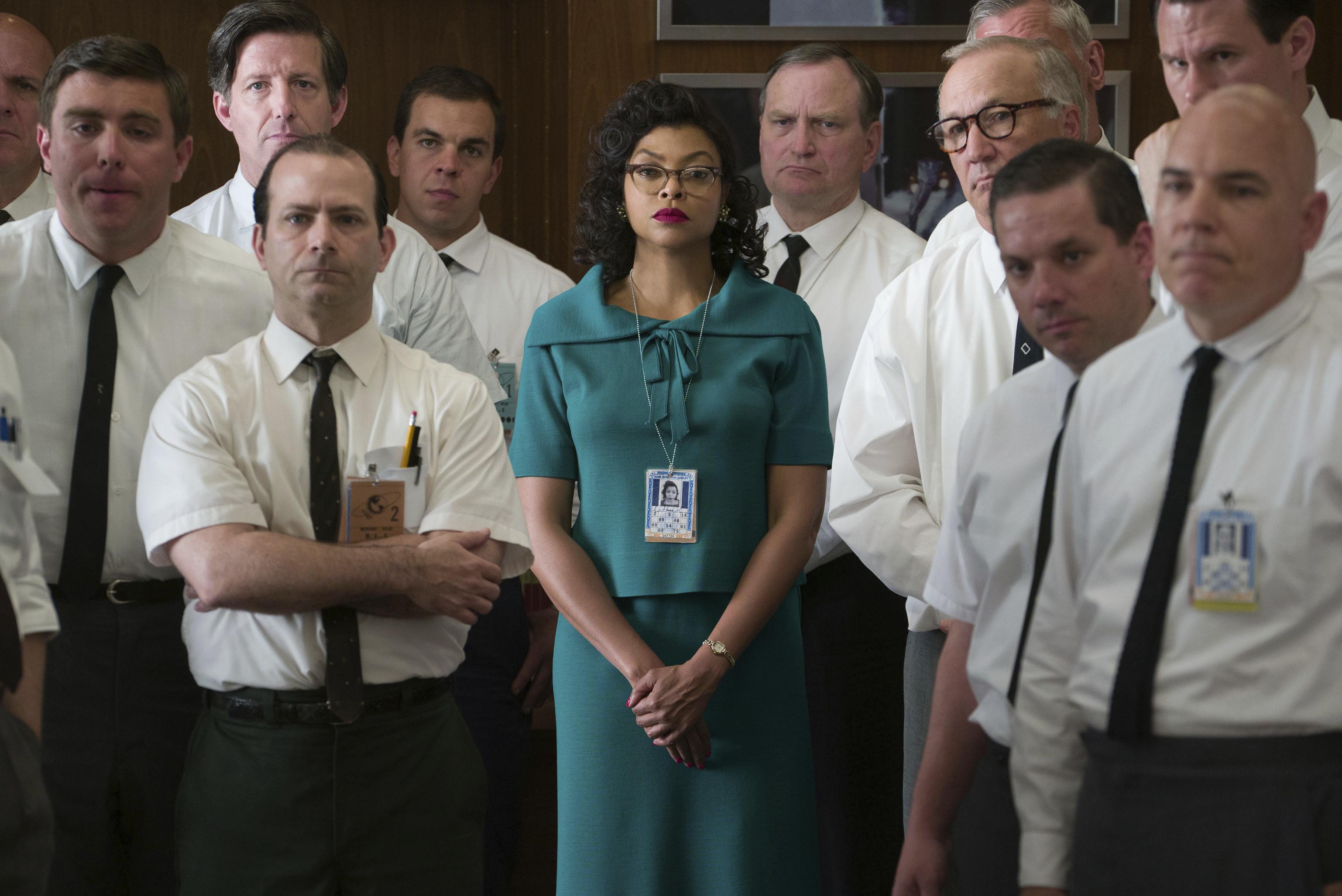 "This image released by Twentieth Century Fox shows Taraji P. Henson as Katherine Johnson, center, in a scene from ""Hidden Figures."" (Hopper Stone/Twentieth Century Fox via AP)"