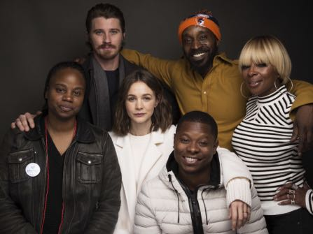 "Director Dee Rees, from left, actors Garrett Hedlund, Rob Morgan, Mary J. Blige, Carrey Mulligan, center, and Jason Mitchell, bottom pose for a portrait to promote the film, ""Mudbound"", at the Music Lodge during the Sundance Film Festival on Saturday, Jan. 21, 2017, in Park City, Utah. (Photo by Taylor Jewell/Invision/AP)"