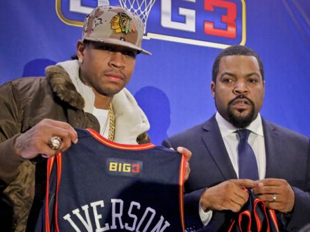 """Former NBA player Allen Iverson, left, shows his jersey as he poses with entertainment legend Ice Cube, right, after they announced the launch of the """"BIG3, a 3-on-3 half-court professional basketball league for retired players, Wednesday Jan. 11, 2017, in New York. """"We are bringing together some of the baddest names to ever play the game,"""" said league co-founder Ice Cube. """"I personally can't wait to see my favorite player back in action."""" (AP Photo/Bebeto Matthews)"""