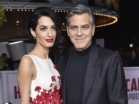 "FILE - In this Feb. 1, 2016 file photo, Amal Clooney, left, and George Clooney arrive at the world premiere of ""Hail, Caesar!"" in Los Angeles. The couple wed on Sept. 27, 2014, in Venice, Italy. The Clooneys are expecting twins in June, Julie Chen said Thursday on CBS' ""The Talk."" George Clooney told Chen in late January that his wife, a human rights attorney, was pregnant, ""The Talk"" host said. (Photo by Jordan Strauss/Invision/AP, File)"