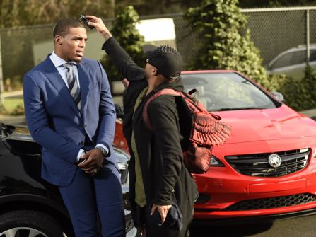 HOLD FOR STORY -- NFL player Cam Newton gets primped before getting his picture taken during the filming of a Buick commercial for this year's Super Bowl telecast, on Friday, Jan. 13, 2017, in Los Angeles. (Photo by Chris Pizzello/Invision/AP)